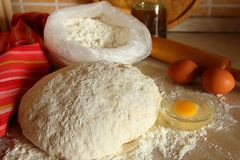 Yeast dough, eggs, and flour Stock Image