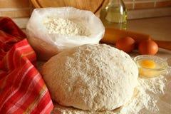 Yeast dough, eggs, and flour Royalty Free Stock Photos