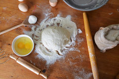 Yeast dough. Eggs  and flour on wooden background Royalty Free Stock Photography