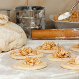 Yeast dough with flour. Making apple pies. Stock Photos
