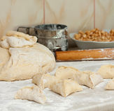Yeast dough with flour. Making apple pies. Royalty Free Stock Images
