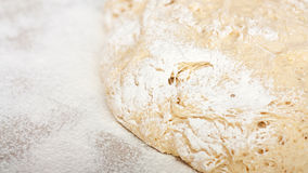Yeast dough with flour. Making apple pies. Royalty Free Stock Photo