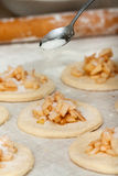 Yeast dough with flour. Making apple pies. Royalty Free Stock Image