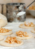 Yeast dough with flour. Making apple pies. Stock Photo