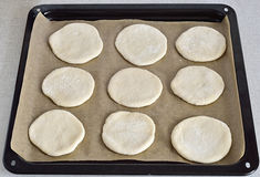 Yeast dough on the parchment Stock Images