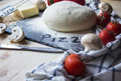 Yeast dough for pizza. And ingridients: mushrooms tomatoes and cheese Stock Images
