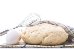 Yeast dough raw eggs and whisk Royalty Free Stock Photo
