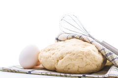 Yeast dough raw eggs and whisk Stock Photo