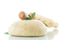 Yeast dough. With a wooden rolling pin on a white background Stock Photos
