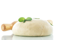 Yeast dough. With a wooden rolling pin on a white background Royalty Free Stock Photo