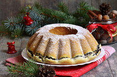 Yeast orange christmas cake with poppy seed filing. Royalty Free Stock Images