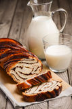 Yeast roll with chocolate and poppy seed with milk. Stock Images
