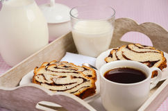 Yeast roll with chocolate and poppy seed with tea and milk. Stock Images