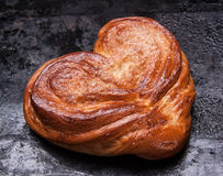 Yeast sweet buns in the shape of a heart on black baking tray. Country house style. Authentically Royalty Free Stock Photos