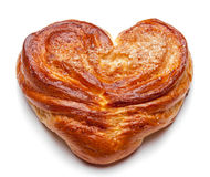 Yeast sweet buns in the shape of a heart on an white. Country house style. Authentically Stock Photos