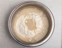 Yeast water and floor for dough. PIZZA RECIPE, stage 1 - yeast water and floor for dough Royalty Free Stock Photo
