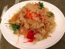 Yee Sang Prosperity Toss. Yusheng, yee sang or yuu sahng, or Prosperity Toss, also known as lo hei is a Teochew-style raw fish salad stock photo