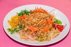 Yee Sang or Yusheng, traditional Chinese New Year prosperity del. Yee Sang or Yusheng with raw salmon fillet, traditional Chinese New Year prosperity delicacies royalty free stock images