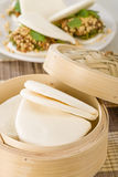 He Yeh Bao. Chinese steamed buns used to make sandwiches. Gua bao on background Royalty Free Stock Photo