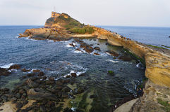 Yehliu Geopark. The rock landscape of Yehliu Geopark is one of most famous wonders in the world. The costal line is stretching in a direction vertical to the stock photos