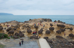 Yehliu Geopark in Taiwan. Tourists at the Yeliu Yehliu Geopark in Wanli, New Taipei, Taiwan Royalty Free Stock Photography