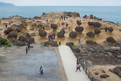 Yehliu Geopark in Taiwan. Tourists at the Yeliu Yehliu Geopark in Wanli, New Taipei, Taiwan Royalty Free Stock Photos