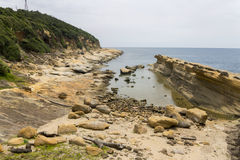 Yehliu rock formations and coastline. Yehliu geologic park in summer. Yehliu is a cape on the north coast of Taiwan in the town of Wanli. The cape, known by Stock Images
