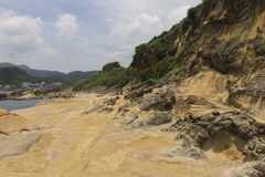 Yehliu rock formations and coastline. Yehliu geologic park in summer. Yehliu is a cape on the north coast of Taiwan in the town of Wanli. The cape, known by Stock Photography