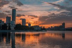 Yekaterinburg city center on sunset. City pond view, amazing clouds and sky. High buildings, skyscrapers on the embankment. Of the river Iset royalty free stock photos