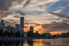 Yekaterinburg city center on sunset. City pond view, amazing clouds and sky. High buildings, skyscrapers on the embankment. Of the river Iset royalty free stock photography