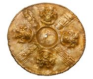 Golden disc of ancient Peruvian Chimu culture. Yekaterinburg, Russia - January 17, 2019: golden disc of ancient Peruvian Chimu culture with images of the god Ai stock photography