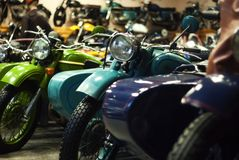 Vintage motorcycles with strollers in the museum of retro cars royalty free stock photo