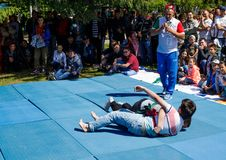 Tatar belt wrestling, kuresh. Traditional national holiday Sabantuy in the city park royalty free stock photo