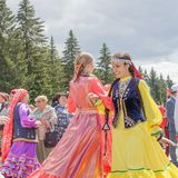 Two girls in national clothes are dancing in the foreground royalty free stock photos
