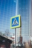 Yekaterinburg, Russia, May, 10, 2019: Road sign pedestrian crossing on background of Hyatt hotel building business center and Iset. Tower in the Yekaterinburg stock photo