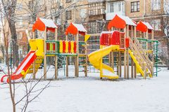 Yekaterinburg, Sverdlovsk Russia - 29 10 2018: A children`s playground with colored red blue yellow wooden houses and slides with royalty free stock image