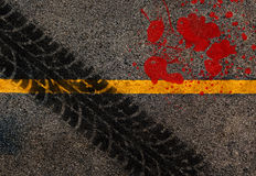 YelConceptual of accident. Yellow line on the high way.Conceptual of accident between tire track and blood .Used film filter for old color tone Stock Photography