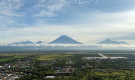 Yelizovo town and Avachinskaya group of volcanoes. Stock Image