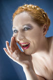 Yell. The red-haired woman yells put his hand to his mouth Royalty Free Stock Photo