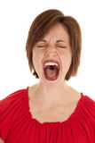 Yelling. A woman yelling out of her mouth with anger royalty free stock photography