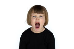 Yelling angry girl missing teeth. A young girl is yelling with her mouth open, angry, missing teeth Royalty Free Stock Image