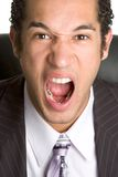 Yelling Business Man. Angry yelling mad business man Stock Image