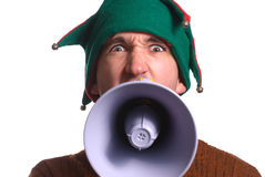 Yelling Elf. An adult Christmas elf is yelling into a megaphone and facing the camera Royalty Free Stock Photos