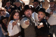 Yelling Gunfighters Royalty Free Stock Photography