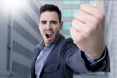 Yelling with his fist in the foreground Royalty Free Stock Photography