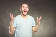 Yelling man in the air. Angry man yelling . Hands are raised in air. Bad emotion face expression Royalty Free Stock Photo