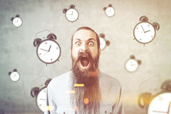 Yelling man and alarm clock, concrete, toned Royalty Free Stock Images