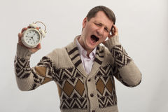 Yelling man with alarm clock in hand Stock Photos