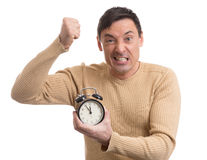 Yelling man with alarm clock in hand Stock Images