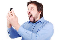 Yelling man on phone. Young attractive man is yelling on his cell phone Royalty Free Stock Images